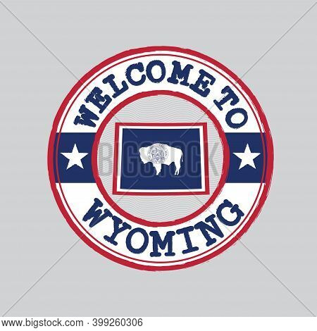 Vector Stamp Of Welcome To Wyoming With Map Outline Of The Nation In Center. The States Of America.