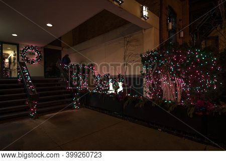 Chicago, Il December 12, 2020, Front Entrance To Apartment Condo Building Decorated Adorned With Chr