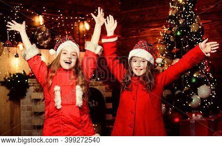 Elf Children. Xmas Children. Christmas Time. Elf Children. Little Girl Sisters In Red Hats. Christma