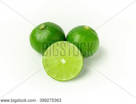 Ripe Slice Of Green Lime Citrus Fruit Stand Isolated On White Background. Lime Wedge. Vegan Food Con