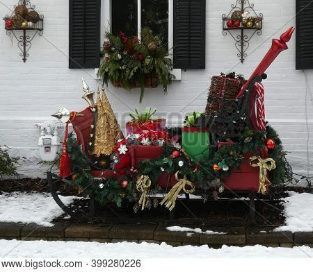 Sleigh With Gifts In The Yard As Christmas Decoration