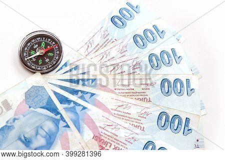 Compass And 100 Turkish Lira Close-up. To Use Turkish Lira For Economy And Investment, Correct And A