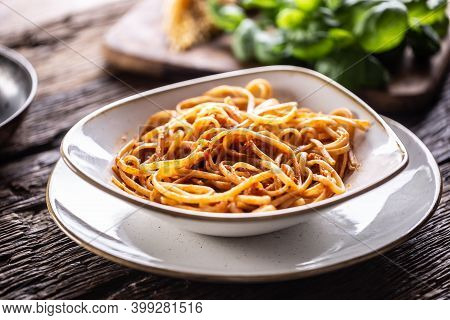 A Plate Full Of Freshlz Cooked Linguini Served On A Rustic Table.