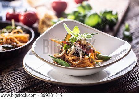Vegetarian Linguini Pasta With Aubergine, Green Peas, Carrot, Pepper And Basil.