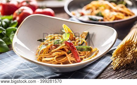 Cooked Linguini Pasta With Vegetables Served On A Plate.
