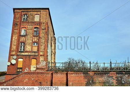 Destroyed, Historic Tenement House And A Red Brick Retaining Wall In The City Of Poznan