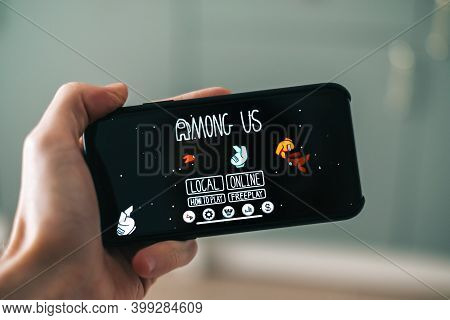 Among Us Game On The Smartphone Screen. High Quality Photo