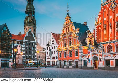 Riga, Latvia - July 1, 2016: Scenic Town Hall Square With St. Peters Church, Schwabe House, House Of