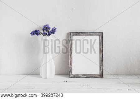 Minimal Home Decor. Empty Portrait Frame Mock-up And Flowers Sea Lavender In A Vase. White Wooden Ol