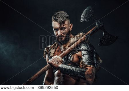 Holding Two Handed Axe On His Shoulder Scandinavian Barbarian In Light Armour With Fur Poses In Dark