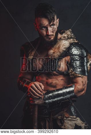 Barbaric And Grimy Northern Vandal In Light Armour With Fur Posing In Dark Background With His Two H