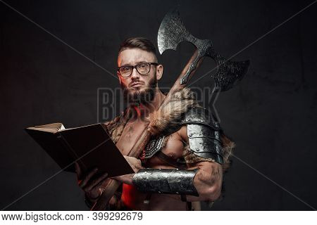 Holding A Book Scandinavian Warrior Weared With Glasses Dressed In Light Armour With Two Handed Axe