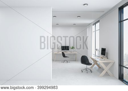 Modern Office Workspace With Computer And Blank White Wall. Coworking Workplace Concept. 3d Renderin