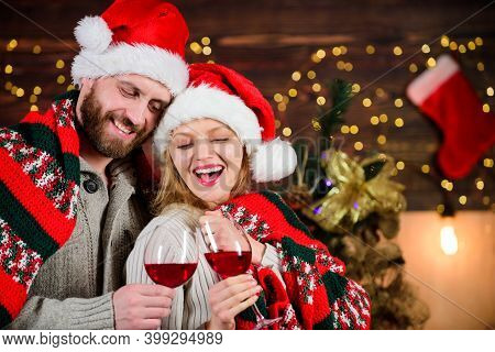 Couple In Love Enjoy Red Wine. Romantic Celebration. Merry Christmas. Celebrating Together. Dearest