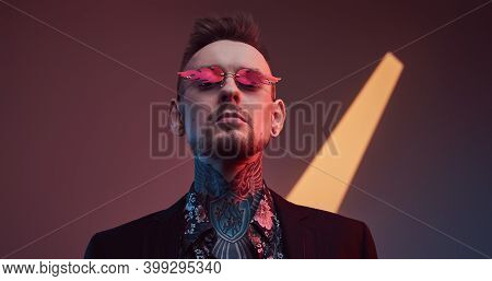 Weared With Sunglasses Stylish And Tattooed Businessperson With Fashionable Haircut And Beard Poses
