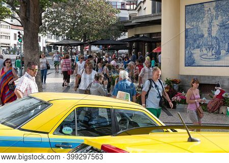 Funchal At Madeira, Portugal - August 01, 2014: People And Taxi Near Entrance Market Hall Mercado Do