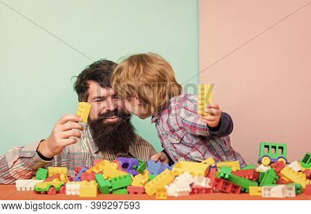 Child Care Concept. Happy Family. Child Development And Upbringing. Father And Son Have Fun. Importa