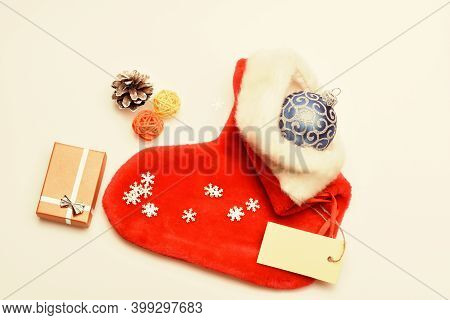 Contents Of Christmas Stocking. Christmas Celebration. Christmas Sock White Background Top View. Sma