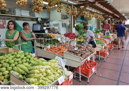Funchal At Madeira, Portugal - August 01, 2014: Two Female Vendors Selling Fresh Vegetables At Famou