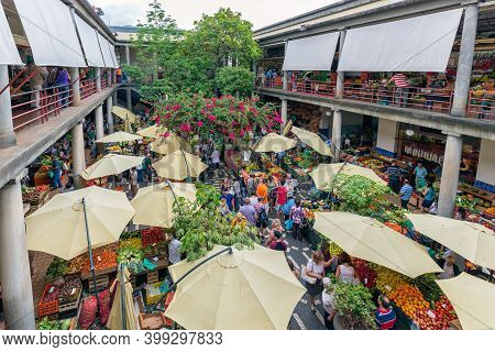 Funchal At Madeira, Portugal - August 01, 2014: Customers Buying Fresh Vegetables At Famous Market M