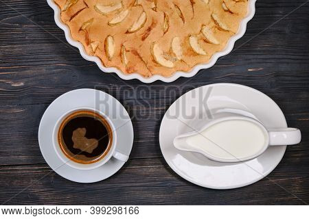 Large Apple Pie And Cup Coffee And Creamer. Fruit Cakes In A Baking Dish. Homemade Pie Of Ripe Apple