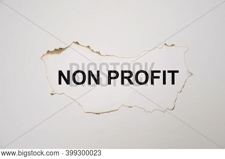 The Word Non Profit Written On A White Sheet Of Paper Which Lies On A White Background