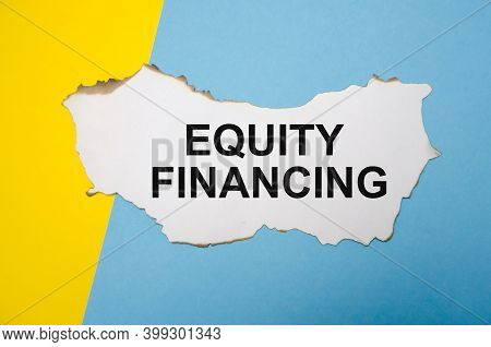 Equity Financing Text Is Written On A White Sheet Of Paper Which Lies On A Yellow-blue Background