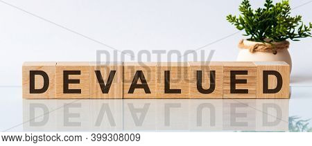 Devalued Text On Wooden Blocks Business Concept White Background. Front View Concepts, Flower In The