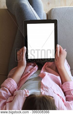 Woman Using Her Tablet With Blank Of Screen