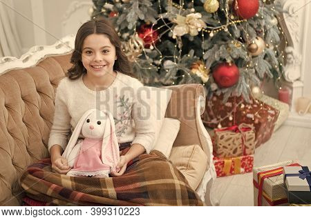 Best Time Of The Year. Adorable Girl Play With Toy In Christmas Eve. Cozy Concept. Smiling Child Enj