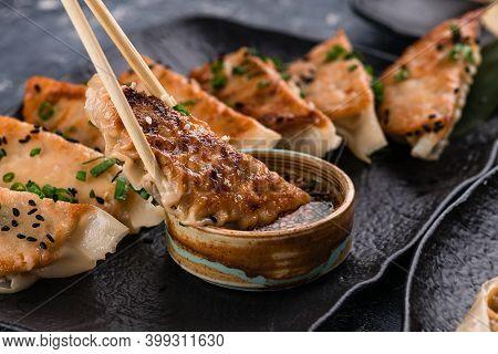 Traditional Asian Pan Fried Gyoza Dumplings With A Dip Sauce, Japaneese Gyoza Dumplings With Meat An