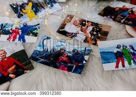 Photo Album In Remembrance And Nostalgia In Christmas, Winter Season, On Wood Floor. Photo Of Retro