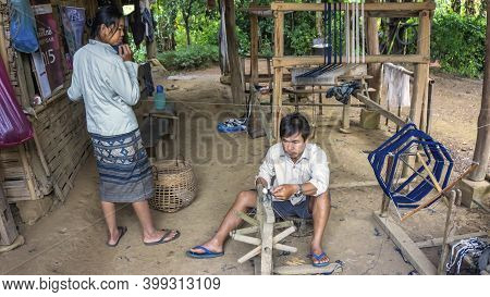 Laos - December 2015: Couple Working At Home On A Weaving Loom, Laos Countryside.