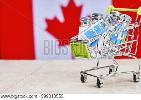Tashkent, Uzbekistan - December 7, 2020: Canada Buys Pfizer Covid-19 Vaccines. Canada Government Rol