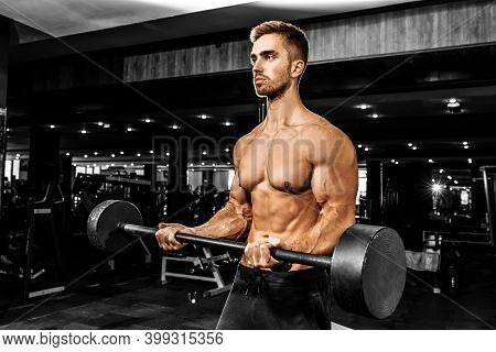 Muscular Bodybuilder Doing Heavy Deadlift With A Barbell In A Modern Gym