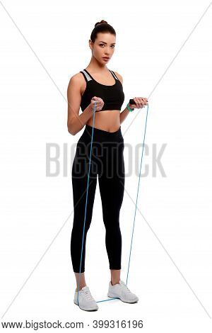 Smiling Fitness Female With Jumping Rope On White Isolated Background. Woman Spots Instructor. Healt