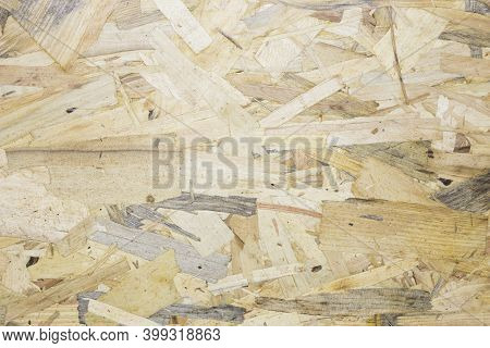 A Close Up Pressed Wooden Panel Background, Seamless Texture Of Oriented Strand Board - Osb Wood