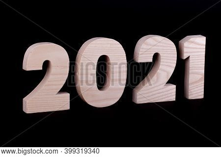 2021 Year Large Wooden Numbers. Hardwood Characters On A Black Background
