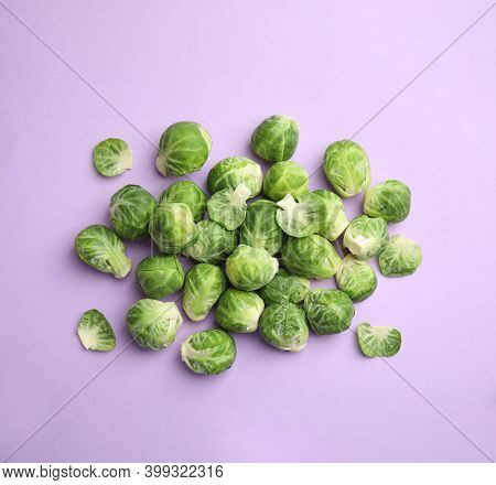 Fresh Brussels Sprouts On Violet Background, Flat Lay