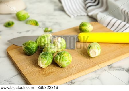 Fresh Brussels Sprouts On White Marble Table, Closeup