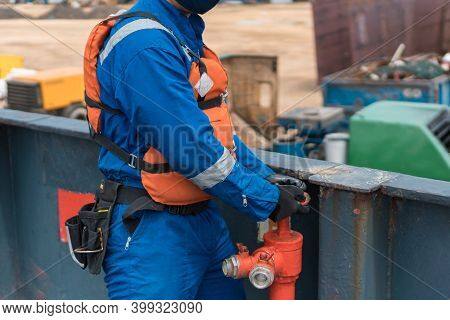 Marine Deck Officer Or Chief Officer On Ship's Deck Performing Work