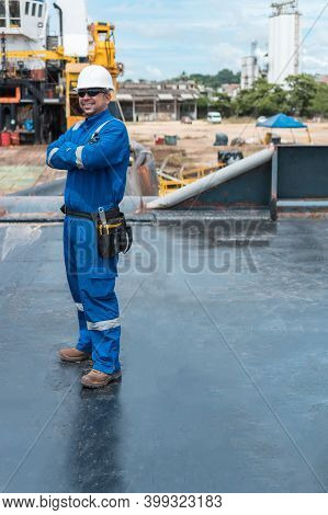 Hispanic Deck Officer On Ship Deck, With Ppe Personal Protective Equipment. Dream Job At Sea