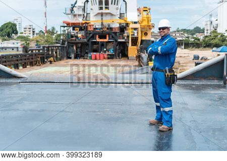 Marine Deck Officer Or Chief Officer On Deck Of Ship Or Seagoing Vessel, With Ppe Personal Protectiv