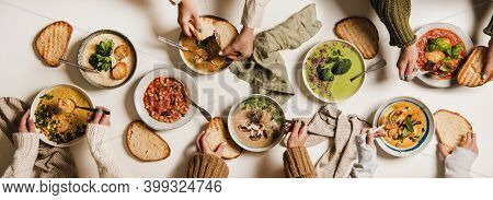 People Eating Autumn And Winter Creamy Vegan Soups, Fall And Winter Vegetarian Food Menu. Flat-lay O
