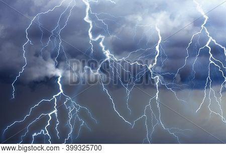 Lightnings In Dark Cloudy Sky During Thunderstorm