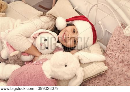 Make A Wish, Say Good Night. Happy Child Go To Sleep On Christmas Eve. Little Girl Cuddle Toys In Be