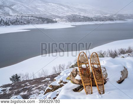 winter scenery of Horsetooth Reservoir in northern Colorado with classic Bear Paw snowshoes