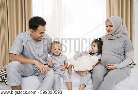 Portrait Of A Happy Family In Piyama Clothes.