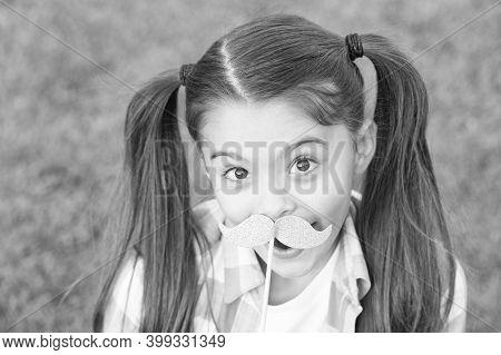 Salon Photobooth. Happy Child Hold Fake Mustache. Playful Girl Party On Green Grass. Beauty Salon. F