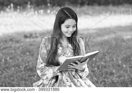 Dream Big, Read. Happy Kid Read Book In Summer Park. Little Reader Outdoors. Summer Reading List. Fa